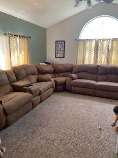Sectional couch with recliners on 4 of the pieces