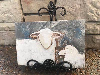 Painted sheep on wood with metal easel