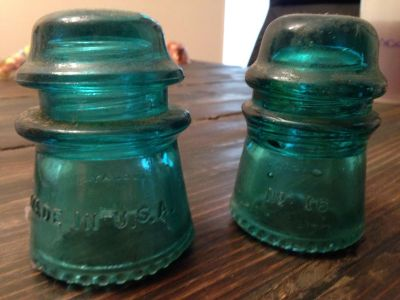 Two antique electrical insulators