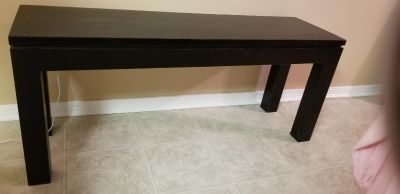 GUC dark brown solid wood side table , would be super cute painted , small crack pictured