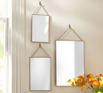 New Pottery Barn gold hanging mirror