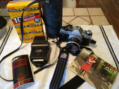 Cannon A-1 for parts or repair with standad and 100-200mm zoom lens, flash and case.