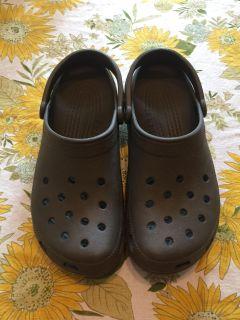 Crocs. Men s 10, Women s Size 12. New. Husband worn a few times after injuring his foot. $10. Quick pick up behind YMCA