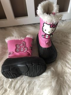 Cute like new hello kitty very light weight boots size 5/6. The Black has silver sparkle
