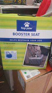 New in box. Dog booster seat. Fits dogs up to 30 lbs