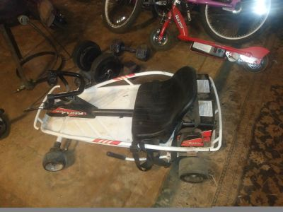 Razer go kart. Has new batteries 8 yrs old to ride holds 140 pounds..