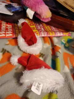 New with tags tiny little Santa hats