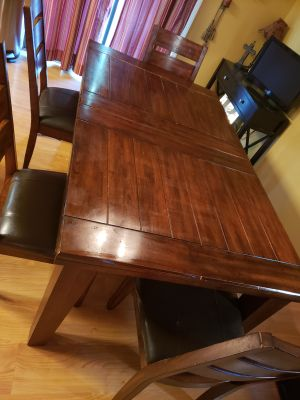 Ashley brand solid wood table