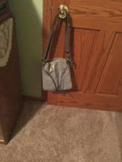 Grey adorable purse, very soft.zipper on back with organizer.two zippers down the front.