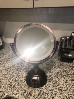 Makeup magnifying rubbed bronze mirror