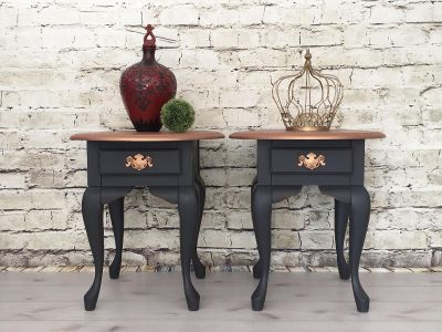 A pair of stunning wood tables. Nice design, finished all 4 sides, painted a dark grey, distressed and copper top & pulls.