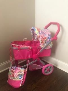 Toy baby stroller with diaper bag