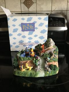 Disney Pooh musical figurine. Eeyore and Pooh spin around by magnets as it plays Winnie the Pooh