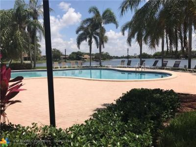 THIS 3 BEDROOM 2 BATHROOM 1 CAR GARAGE HOME SITS ON THE LAKE FOR FANTASTIC VIEWS.