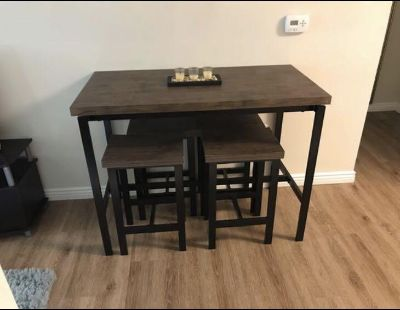 counter height table with stools (center piece included if interested)