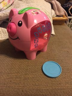 Fisher price smart stages piggy bank coin counter... Only one coin hence the price