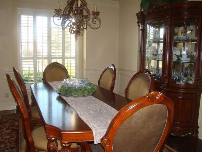 Dining table, 6 oversized chairs, and China cabinet.