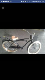 Huffy beach cruiser with basket and cup holder