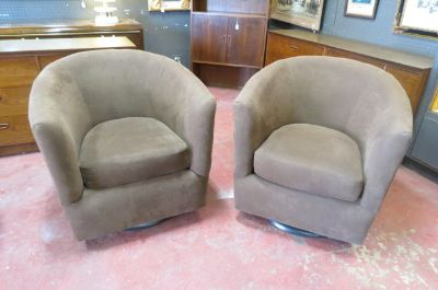 Vintage mid century pair of swivel lounge chairs