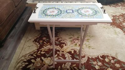 Beautiful mosaic table sealed with epoxy. 26 x 15. 27 high.