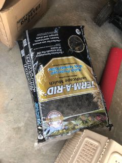 New in bag three bags of black mulch