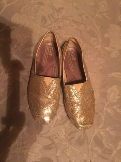 Gold glittery Toms shoes 7.5