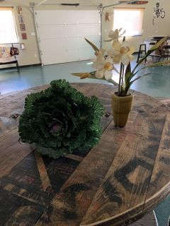 Floral arrangement in vase and floral cabbage accent piece. Brazoria home pickup.