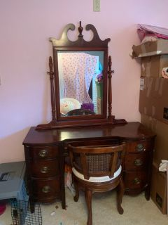 Vanity with mirror and chair