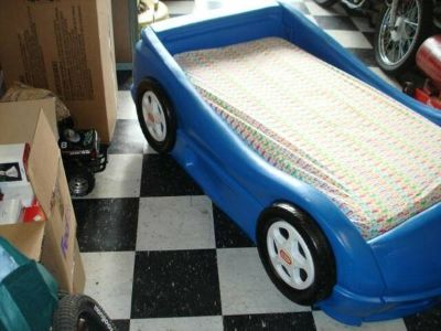 blue little tikes car bed comes complete with crib size mattress