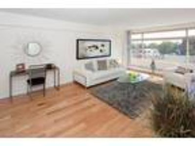 This great One BR, One BA sunny apartment is located in the area on Beacon St.
