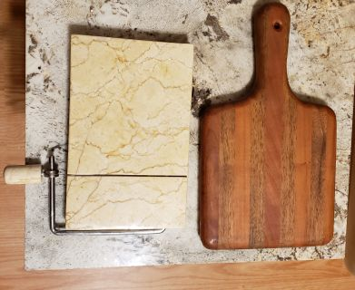Marble chees slicer and butcher block cheese board $10