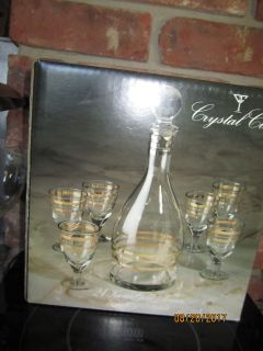 U.S.S.R (now Russia) A 7 piece Crystal Cordial Set  having 24 Karat Gold Accents NEW. $15