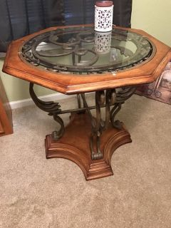 2 glass top tables with wrought iron base