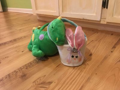 2 Easter baskets, dinosaur which is the bigger one and the small one is a bunny.