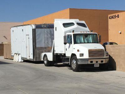 Freightliner FL70 w/ trailer