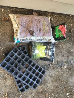 Full Bag of Organic Compost, Full Bag of Seedling Mix, 2 Seedling Trays, Moisture Sensor, & Partial Bag of Vermiculite
