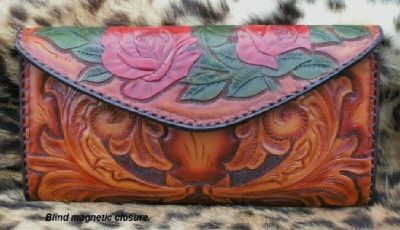 $399 OBO Hand tooled clutch purse