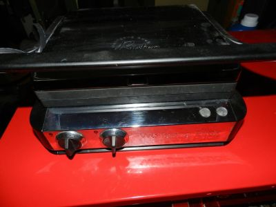 The Wolfgang Puck Electric Reversible Tri-Grill/Griddle