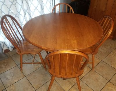 Solid wood oak dining table and 4 chairs