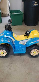 Ride on toy powered car. 4 wheeler.
