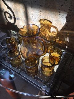 Beautiful tiger's eye pattern pitcher and 8 glasses. Handcrafted. Tray extra.