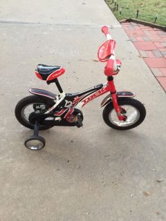 """Childs trek jet 12 red bike with 12"""" wheels with stabilizers-retails for $159.00"""