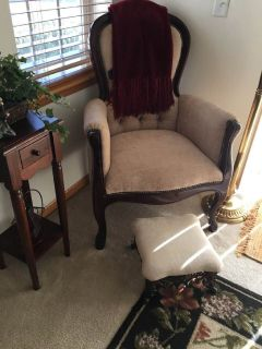Vintage looking chair with foot stool and side table