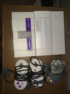 Super Nintendo system and 21 games lot