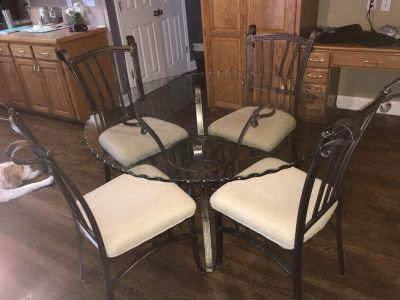 Glass top round table with chairs