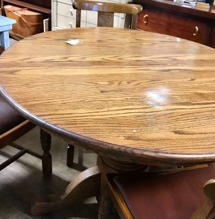 Round oak table and chairs.