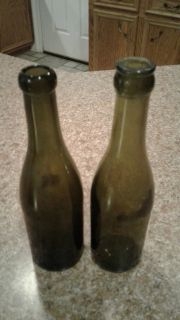 2 old green bottles with cork top