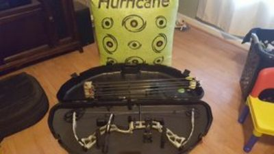 Diamond Outlaw compound bow and target