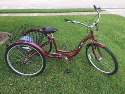 Schwinn adult tricycle with basket and helmet