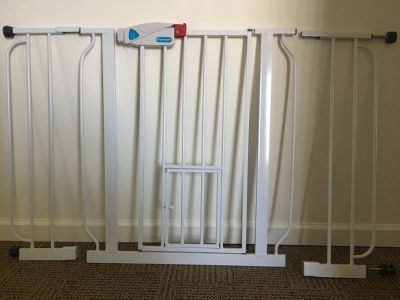 Extra tall baby gate with pet door and side extenders